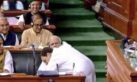 Rahul Gandhi gives surprise hug to bitter foe Modi in parliament