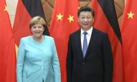 China, Germany defend business with Iran in face of U.S. threats