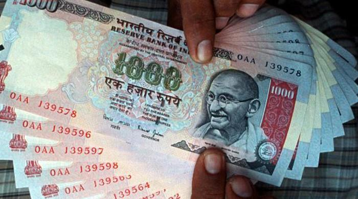 India's falling rupee a ´double-edged sword´ for economy: analysts