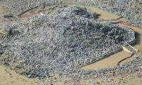 Muslim pilgrims scale Mount Arafat for peak of hajj