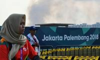 Firefighters tackle large blaze outside Asian Games venue