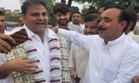 Fawad Chaudhry presented dollar garland in Jhelum