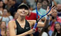 Sharapova lights up US Open again with win over Ostapenko
