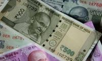 India's rupee hits record low against dollar