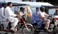 Ban on pillion riding lifted in Karachi