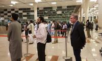Selfies galore as passengers finds FM Qureshi waiting in queue at airport