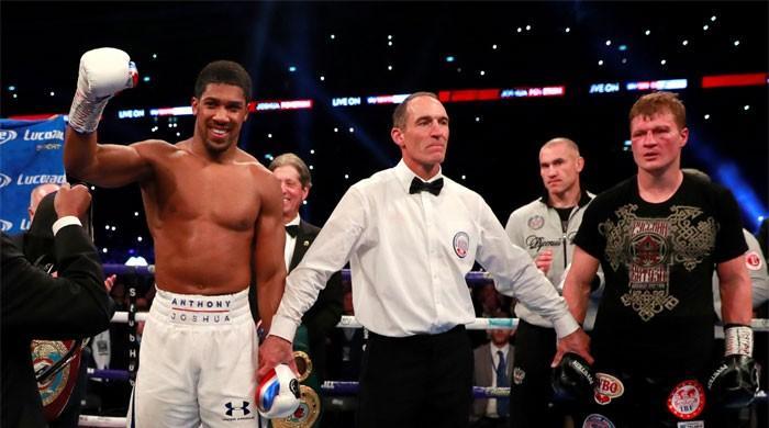 Joshua retains world heavyweight titles with Povetkin stoppage