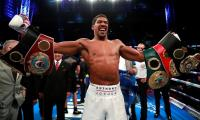 Joshua overpowers Povetkin to retain world heavyweight titles
