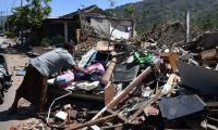 Indonesia calls off grim search for dead in quake-tsunami