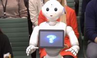 A walking and talking robot appears in Britain's parliament