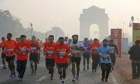 Thousands of runners compete in smoggy Delhi half marathon
