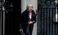 UK´s May takes Brexit deal to cabinet as MPs revolt