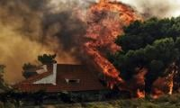 Death toll from California wildfires rises as 130 still missing