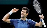 Perfect Djokovic gears up for ATP Finals last-four with win