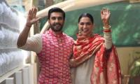 Newlyweds Deepika and Ranveer land back home for Griha Pravesh