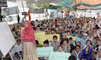 Protesting dock workers establish street school to continue their kids' education