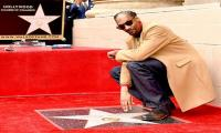 Snoop Dogg receives star on Hollywood walk of fame, thanks his own self