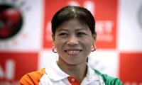 India´s Kom marches toward record 7th world champ medal