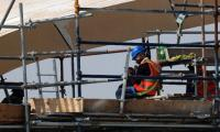 Four years to go but little World Cup joy for Qatar workers