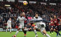 Salah hat-trick sends Liverpool top, Man Utd finally click