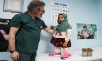 Syrian girl born without legs walks on new prosthetics
