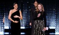Meghan presents fashion award to wedding dress designer Waight Keller