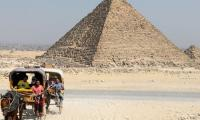 Egypt arrests two over nude tourists on pyramid