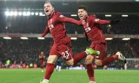 Liverpool beat Manchester United 3-1 to regain top spot