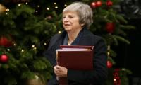UK PM May survives confidence vote after Brexit humiliation