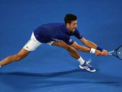 Djokovic survives examination to reach Open quarters