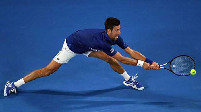 Djokovic survives examination to reach Open quarters