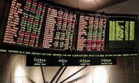 Asian markets rise as investors track trade talks, US shutdown