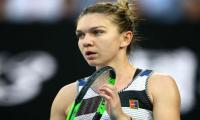 Halep returns to second despite Doha final defeat