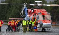 Stricken liner sails for port after hundreds airlifted to safety