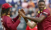 Windies name Gayle and Russell in World Cup squad, Pollard misses out