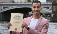 Refugee footballer votes after getting Australian citizenship
