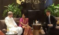 FM Qureshi, Sushma Swaraj meet in Kyrgyzstan; Indian minister brings sweets for Pakistani counterpart