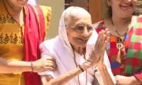 Modi's 99-year-old mother joins celebrations as she greets BJP supporters outside her house
