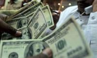 Dollar climbs to Rs156.80