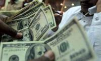 Dollar climbs to Rs156.80