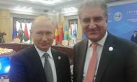 Putin, FM Qureshi pose for camera