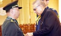 President Dr Arif Alvi confers Nishan-i-Imtiaz (M) upon Chinese General
