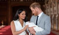 Baby Archie takes after Prince Harry with 'tufts of reddish hair'