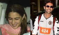 Sara Ali Khan can't help but blush as she picks up Kartik Aaryan from the airport