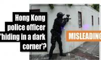 Fact-check: Hong Kong police officer 'hiding in a dark corner'?
