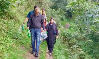 President Arif Alvi picks up trash on hiking trip in Changla Gali