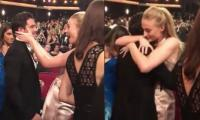 Sophie Turner breaks down in tears as she hugs Kit Harington at the Emmys