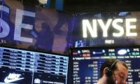 US stocks end lower as market awaits trade talks