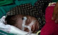 ´Miracle survival´ for newborn found in Indian grave