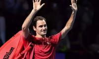 Federer celebrates 1,500th match with Basel breeze